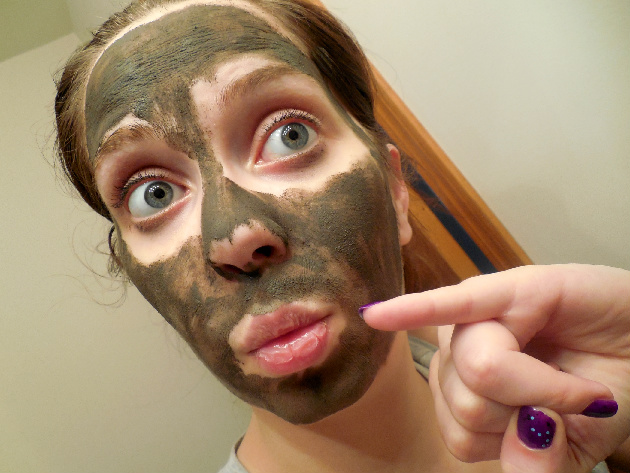 wearing a mud mask